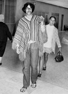 An air traveler wears a poncho at San Francisco International Airport. Sept.1970. Morgue01